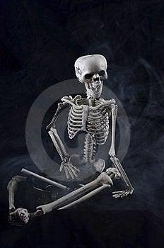 Skeleton Holding An Ashtray Royalty Free Stock Image - Image: 21391306