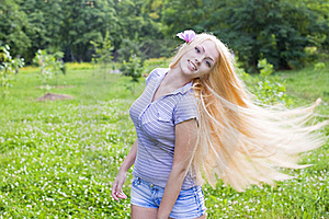 Sexy Young Female Smiling In A Park Royalty Free Stock Image - Image: 21393126