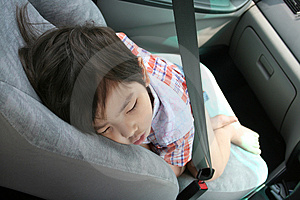 Boy fasten seat belt sleeping Stock Photos