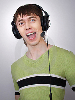 The Joyful Active Boy In Ear-phones Sings Stock Photo - Image: 21400710