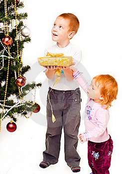 Children Decorate A New-year Tree Stock Photography - Image: 21403762