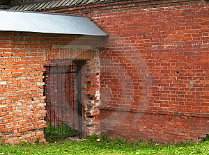 Openwork Gate In The Brick Wall Royalty Free Stock Photography - Image: 21425627