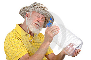 Senior Man Looking Into Empty Bottle Royalty Free Stock Photography - Image: 21426577