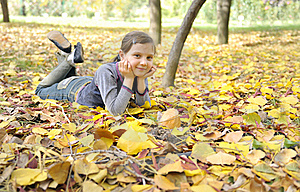 Girl Lying On Fall Leaves Outdoors Royalty Free Stock Image - Image: 21432466