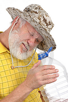 Senior Man Looking Into Empty Bottle Royalty Free Stock Photography - Image: 21441047