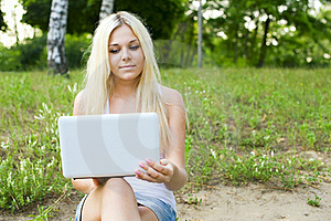 Closeup Of A Young Girl Using Laptop Stock Photos - Image: 21441283