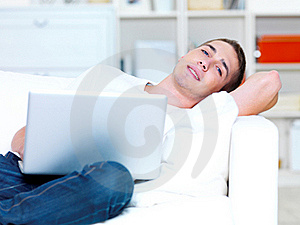 Young Man Using Laptop Royalty Free Stock Photo - Image: 21451015