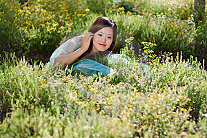 Young Beautiful Girl Laying On The Flowers Field Royalty Free Stock Photography - Image: 21461377