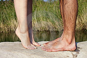 couple feet kissing near lake Stock Image