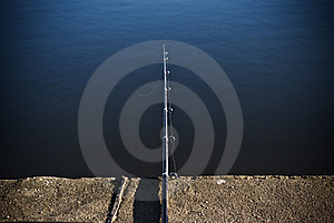 Fishing Rod On The Pier Stock Photo - Image: 21473520