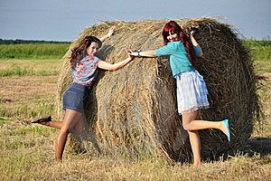 Girls Standing By Haystacks Stock Images - Image: 21493344