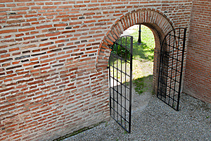 Opened Iron Forged Gate With Brick Wall Stock Photography - Image: 21494452
