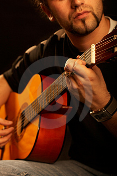 Guitarist in contre-jour light Free Stock Photos