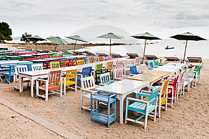 Tables, Chairs, Colorful Seaside Stock Photography - Image: 21514622