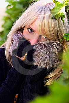 Lovely Blond Woman Looks And Hides Royalty Free Stock Images - Image: 21524609
