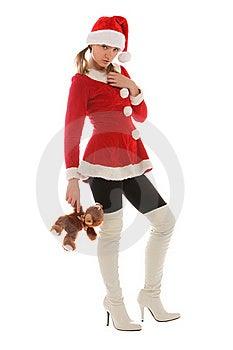 Santa's Helper Holding A Bear Stock Photography - Image: 21576142