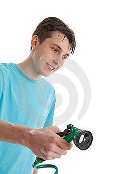 Boy Using A Garden Hose Royalty Free Stock Photos - Image: 21596538