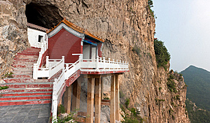 The Temple Was Built In The Cliff Royalty Free Stock Photo - Image: 21656265