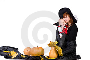 Halloween Baby With Mother Near Pumpking Stock Image - Image: 21675321