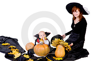 Halloween Baby With Mother Near Pumpking Royalty Free Stock Photos - Image: 21675358
