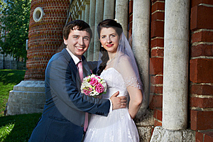 Happy Bride And Groom With Bouquet Royalty Free Stock Photos - Image: 21677228