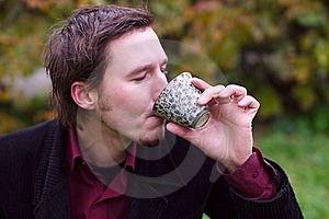 Handsome Man Drinking Tea Outdoors Royalty Free Stock Images - Image: 21730759