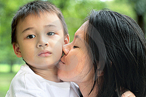 Mother Kiss Her Son Stock Image - Image: 21747801