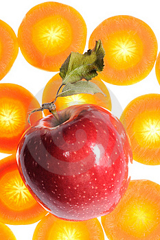 Red Apple On Carrot Background Stock Photos - Image: 21756163