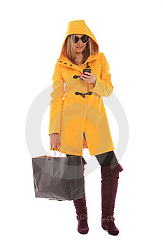Woman Checking Messages While Shopping Stock Photo - Image: 21780300