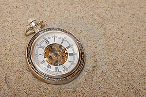 Old Pocket Watch Buried In Sand. Royalty Free Stock Image - Image: 21804236