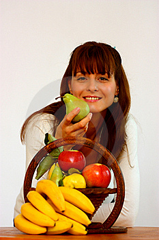 Woman Holding A Pear Stock Image - Image: 21812771