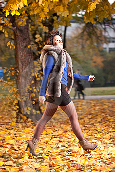 Woman At Autumn Walking On Yellow Leafs Royalty Free Stock Images - Image: 21821769