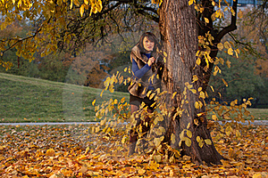 Model Looking From Behing The Tree Stock Image - Image: 21821911