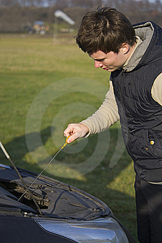 Man Checks Oil Level Royalty Free Stock Image - Image: 21834186