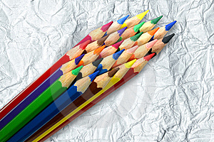 A Stack Of Colored Pencils On Crumpled Paper Backg Stock Images - Image: 21844004