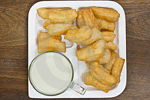 Deep Fried Dough Sticks And A Cup Of Soybean Milk Royalty Free Stock Photography - Image: 21884777