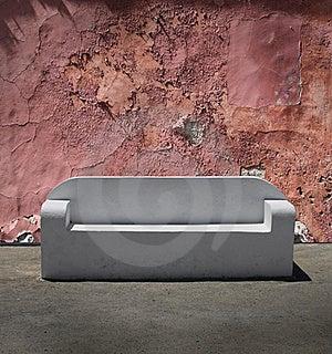 Stone Sofa Cracked Plaster Wall Royalty Free Stock Image - Image: 21890346