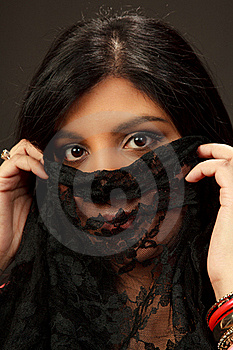 Beautiful Indian Girl Holding Up A Vale Stock Photos - Image: 21945753