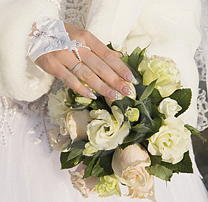 Hand Of Fiancee On A Bouquet From Roses Stock Image - Image: 21967511