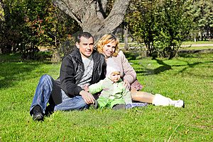 Small Beautiful Girl With Parent On Green Glade Royalty Free Stock Photo - Image: 21985095