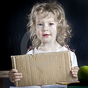 Schoolchild With Paper Blank Stock Image - Image: 21989641