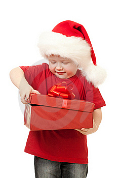 Adorable Boy In Santa Hat Opening Christmas Gift Royalty Free Stock Photos - Image: 21992938