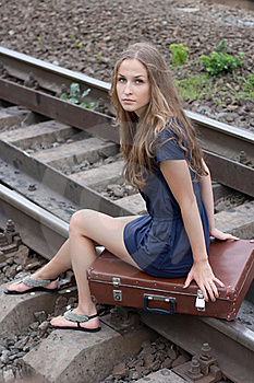 Woman Sitting On Rails Stock Images - Image: 21996154