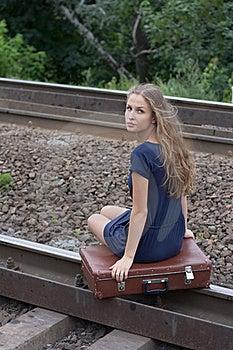 Woman Sitting On Rails Stock Photo - Image: 21996380