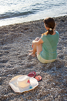 The Girl, Hat And Flip-flops On The Stones Stock Images - Image: 21999154