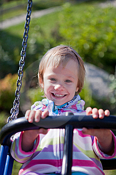 Little Girl On The Swing. Stock Images - Image: 21999384