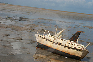 Wood carving of a ship stranded on the beach Stock Photo
