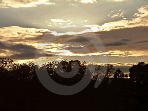 A burst of light from behind clouds Stock Photo
