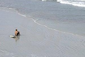 Persona que practica surf vigilante Imagenes de archivo