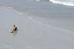 Surfista observador Imagens de Stock